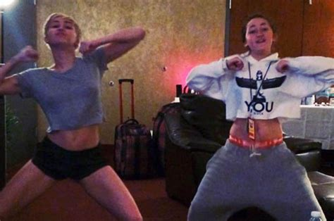 Miley Cyrus twerks and booty-shakes with little sister