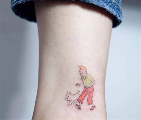 Tintin and Milou tattoo on the ankle